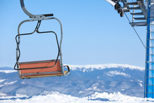 Empty Chairlift At Mountain Ski Resort, Space For Text. Winter Vacation
