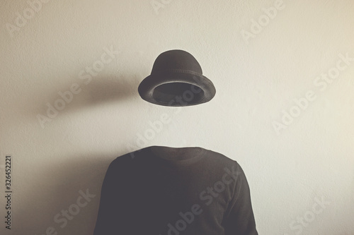 Canvas Print invisible man wearing black bowler, surreal concept of absence of identity