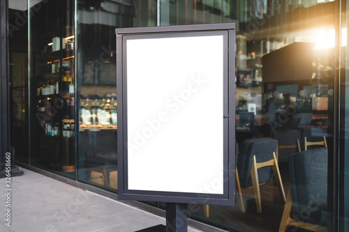 Mock up front view blank billboard advertising in black frame with clipping path standing in restaurant Fototapete
