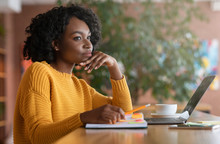 Thoughtful Afro Woman Looking For New Job Online