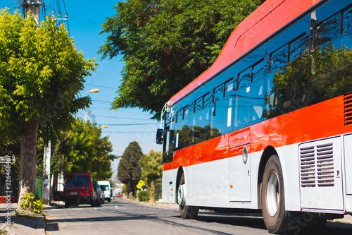 Fototapety, obrazy: SANTIAGO, CHILE - NOVEMBER 2019: A Red Movilidad (Ex Transantiago) bus in Maipú
