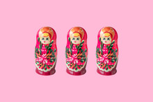 Three Russian Dolls Matryoshka Isolated On Pink Background. Creative Layout With Traditional Moscow Toys