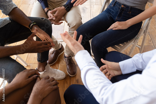 Fototapety, obrazy: Diverse businesspeople talking seated on circle indoors closeup top view