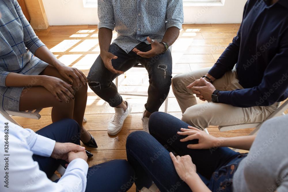Fototapeta Diverse people during psychological rehab session sitting indoors