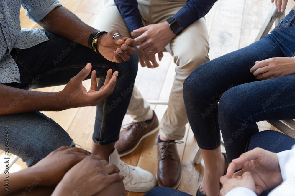 Fototapeta People sitting in circle share problems during psychological rehab session
