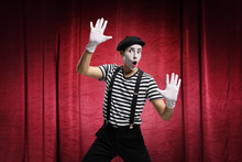 Mime Pretending To Touch An Im...