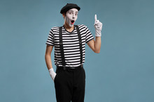 Mime Gesturing With His Finger...