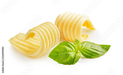 Tableau sur Toile Butter curls or butter rolls with basil leaves isolated on white background