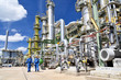 canvas print picture - chemical industry plant - workers in work clothes in a refinery with pipes and machinery