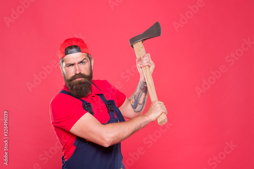 Obraz decisive action. Cutting or wood chopper with sharp blade. Bring more style for bearded face. man worker hold ax. cut his beard. lumberjack carrying ax. employee with axe. mature man ready for hiking - fototapety do salonu
