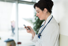 Female Doctor Texting On Smart...