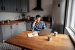 Young male freelancer works from home
