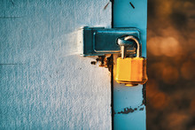 Yellow Padlock On A Door