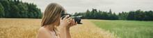 Female Photographer Taking Photos Of Beautiful Nature