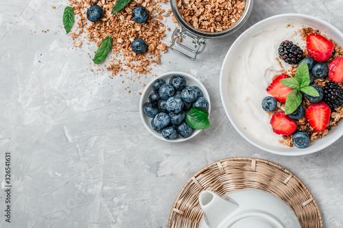Healthy breakfast with granola, yogurt, fruits, berries on white background Wallpaper Mural