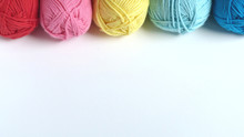 Colorful Yarn On A White Backg...