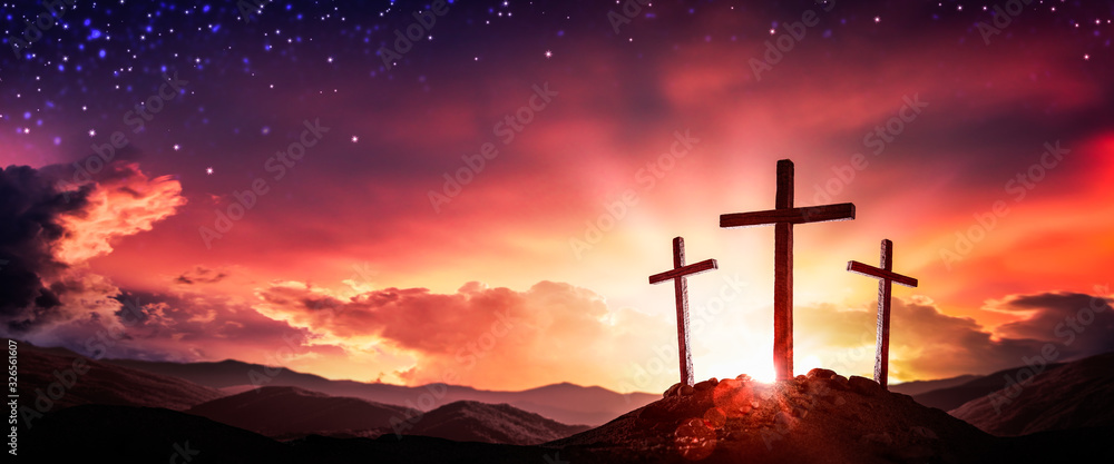 Fototapeta Three Wooden Crosses At Sunrise With Clouds And Starry Sky Background - Death And Resurrection Of Jesus Christ