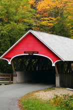 A Covered Bridge Is Surrounded By New England Fall Foliage