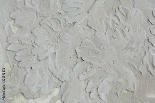 Photo background and texture of a bas-relief pattern on a concrete wall