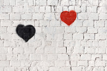 Red And Black Heart On Old White Painted Brick Wall