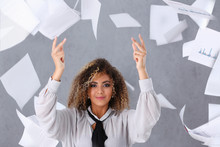 Beautiful Black Woman Portrait. Throws Up Paper With Financial Statistics In Fashion Vogue Style Curly Hair With White Strands View Of The Eye In The Camera