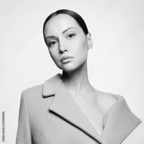 Fashion beautiful lady in beige coat Canvas Print