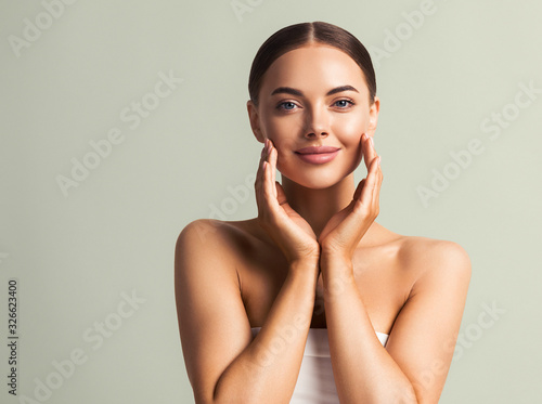 Obraz Beautiful female touching hand skin clean natural make up fresh skin model beauty woman concept healthy and spa - fototapety do salonu