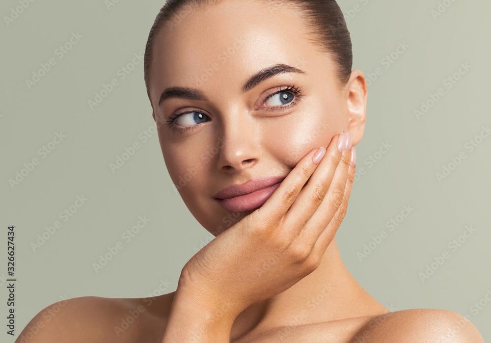 Fototapeta Beautiful woman face close up manicure nails hand touching skin  beauty make up natural healthy clean skin