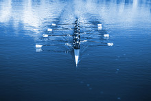Boat Coxed Eight Rowers Rowing On The Tranquil Lake. Classic Blue Pantone 2020 Year Color.