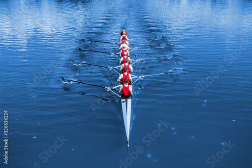 Wallpaper Mural Boat coxed eight Rowers rowing on the blue lake