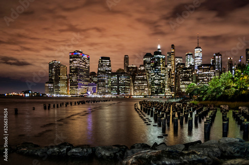 Fototapeta New York Financial District with skyscrapers and an old Brooklyn pier before sunrise obraz na płótnie
