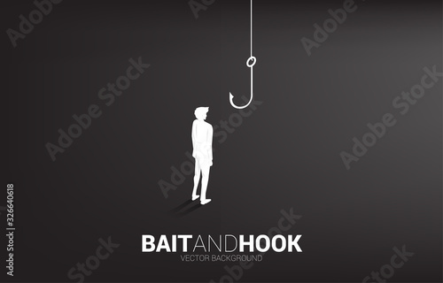 Silhouette of businessman standing with fishing hook Canvas Print