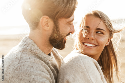 Close up of a smiling beautiful young couple Canvas Print