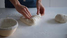 Chef Forming The Dough On A Fl...