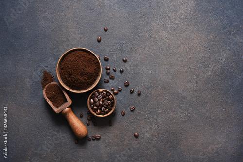 Obraz na płótnie Coffee beans and ground coffee on a concrete table.