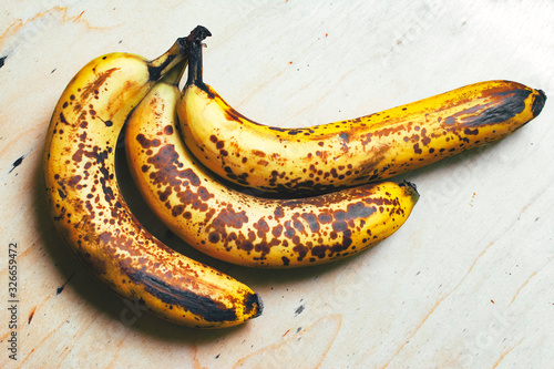 Ripe yellow bananas fruits, bunch of ripe bananas with dark spots on a white background with clipping path Canvas-taulu