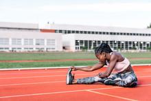 Athlete Sprinter Stretching He...