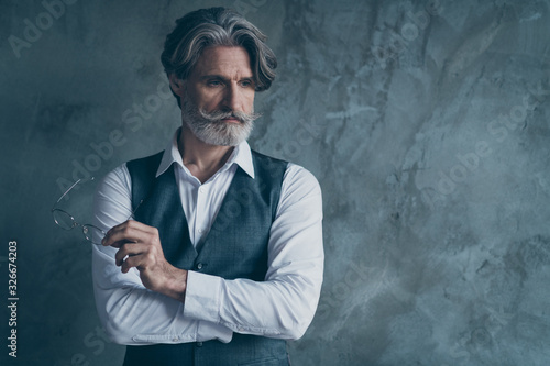 Vászonkép Portrait of rich wealthy stunning old man look copy space hold modern spectacles