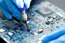Technician Repairing Micro Circuit Main Board Computer Electronic Technology : Hardware, Mobile Phone, Upgrade, Cleaning Concept.