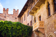 Courtyard Of Casa Di Giulietta House Of Juliet With Famous Balcony Of Juliet From Drama William Shakespeare Romeo And Juliet In Verona, Italy. Romantic Travel Tourism Destination