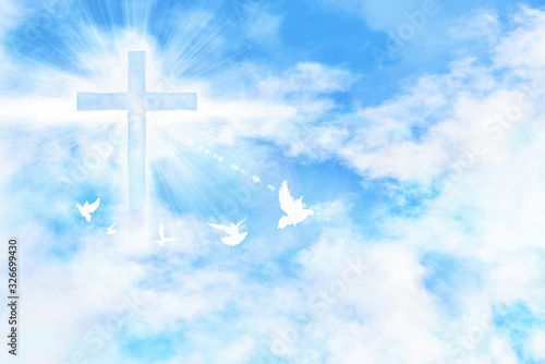 Tableau sur Toile Cloudy blue sky with cross and doves flying
