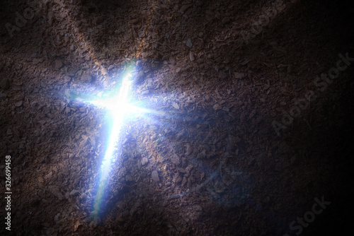 Canvas Print Cross engraved on earth with coming out of it dark