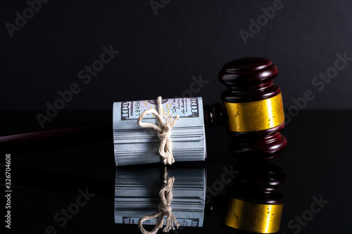 gavel hammer and banknotes with low light view. Canvas Print