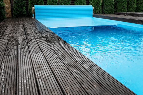 Photo Automatic swimming pool covering system, home and cottage equipment