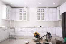 Renovated Kitchen Interior With Stylish Furniture, Refrigerator And Maintenance Equipment