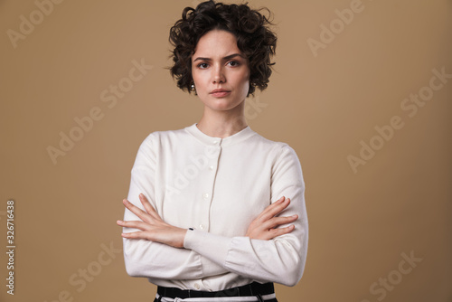 Canvastavla Image of displeased caucasian woman posing and looking at camera