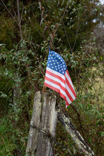 American Flag On Fence Post