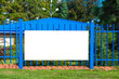 canvas print picture - Blank white banner for advertisement on the fence. Residential area on a sunny summer day.