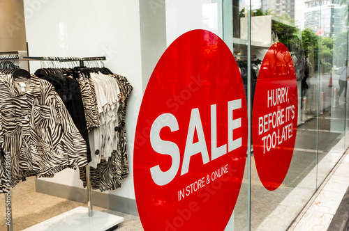Red Sale Sign Sticker on the outside of Fashion Store Windows Fototapeta
