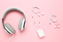 Three Different Earphones On Pink Background